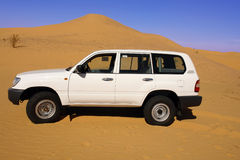 Land Cruiser in the desert.. White Land Cruiser parked in the desert. Horizontal orientation Royalty Free Stock Photography