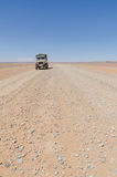 Land Cruiser 4x4 on empty rocky desert road to Erg Chebbi in the Moroccan Sahara, Africa Stock Photos