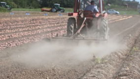 Land cultivation with tractor stock video