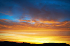 Land and dramatic sky. Land with and dramatic colorful sky at sunset Stock Photos