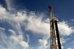 Land Drilling Rig and Cloudy Sky Royalty Free Stock Photo