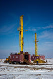 Land drilling rig. Drilling rigs working in the desert Betpakdala Stock Photography