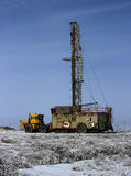 Land drilling rig. Drilling rig working in the desert in the winter Royalty Free Stock Photos