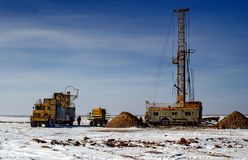 Land drilling rig. Drilling rig working in the desert in the winter Royalty Free Stock Image