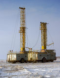 Land drilling rig. Drilling rig working in the desert in the winter Stock Images