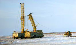 Land drilling rig. Drilling rig working in the desert in the winter Royalty Free Stock Photography