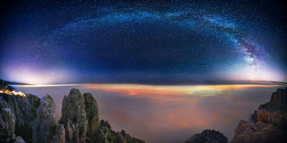 In the Land of Eternity. Milky Way over night clouds in high mountains Stock Images