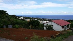 A land for farming. In reunion island, just next to the house, people do farming for growing their own vegetables royalty free stock images