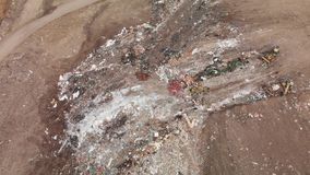 Land fill as trash is being piled up stock footage