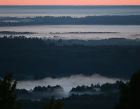 Land of fogs. A photograph of a landscape with fogs before sunrise Royalty Free Stock Photography