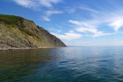 Land, hav och himmel Royaltyfri Bild