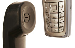 From land line to mobile. Close up shot of a mobile phone and a headset of a land line telephone Royalty Free Stock Photography