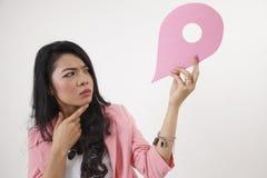 Land mark. Malay woman holding a landmark or location symbol Stock Photos