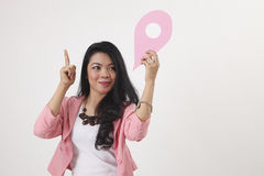 Land mark. Malay woman holding a landmark or location symbol Royalty Free Stock Photos