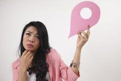 Land mark. Malay woman holding a landmark or location symbol Royalty Free Stock Photography