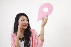 Land mark. Malay woman holding a landmark or location symbol Royalty Free Stock Photo