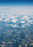 Land mass seen from above, through the clouds. Land mass seen from high above, through the clouds Royalty Free Stock Photos