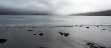 Land meets water at Point Reyes. National Sea Shore California, with dark clouds Stock Photo
