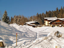 The land of Mont-Blanc, French Alps. Megeve Ski Resort in French Alps, traditional hoses and firs under snow Stock Photos