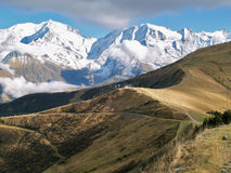 The land of Mont-Blanc, French Alps. View of Mont-Blanc with dramatic blue sky in autumn, French Alps -  the highest mountain in western Europe Royalty Free Stock Photos
