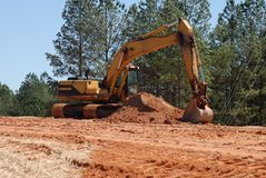 Land Mover. A Land-mover machine clearing mud at a highway construction site Stock Image