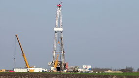 Land oil drilling rig and cranes stock footage