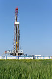 Land oil drilling rig on field Stock Photo