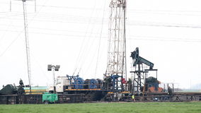 Land oil drilling rig. With workers stock footage