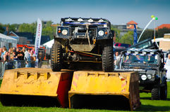Land Rover climbing skips in show arena Royalty Free Stock Photos