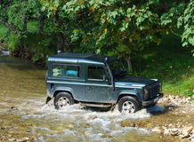 Land Rover crossing river royalty free stock images