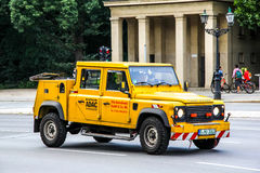 Land Rover Defender. BERLIN, GERMANY - AUGUST 15, 2014: Tow truck Land Rover Defender at the city street Royalty Free Stock Photo