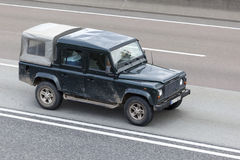 Land Rover Defender on the road Royalty Free Stock Photos