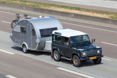 Land Rover Defender with a small Caravan Stock Photo