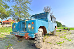 Land Rover Defender used to tow the boat carriage at the morning near Beserah beach, Kuantan Royalty Free Stock Photos