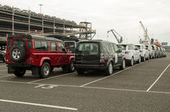 Land Rover Exports, Southampton. SOUTHAMPTON, UK - MAY 31, 2014:  Rows of vehicles made by Land Rover in the UK queued at Southampton Docks awaiting export Royalty Free Stock Image
