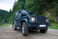 Land Rover on forest road Stock Photos