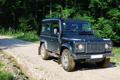 Land Rover on forest road Royalty Free Stock Photos