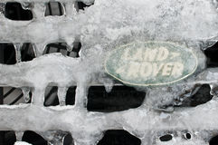 Land rover logo under the ice parallel position. Land rover logo under the ice crystals Royalty Free Stock Images