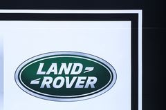 Land Rover logo on a wall. Decines, France - May 24, 2018: Land Rover logo on a wall. Land Rover is a car brand that specialises in four-wheel-drive vehicles Stock Image