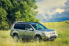 Land-rover in the meadow Stock Images