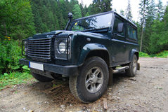 Free Land Rover On Forest Road Stock Photos - 12516303