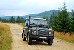 Land Rover, unpaved road Stock Images