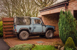 Land Rover - Weekend adventures. Leamington Spa, West Midlands, United Kingdom - January 30, 2016: Land Rover Defender parked at a driveway. Last in line rolled Stock Images