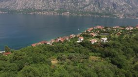 Land for sale in Montenegro. Hotel by the sea. The town of Prcan stock footage