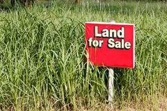 Land for sale sign Stock Photos