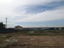 Land for sales concept. Landscape of empty land plot for development, and beautiful blue sky. royalty free stock images