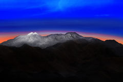 Land scape of snow mountain hill with beautiful dramatic colorfu. L sky before morning dawn light use for nature background and backdrop Stock Photos