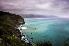 Land and Seascape on California Highway 1 with Turquoise Water and Spring Flowers. Coastal land and seascape on Californias iconic Highway 1 royalty free stock photos