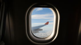 Land seen through the window of jet airplane. Airplane slowly landing. At destination stock video footage