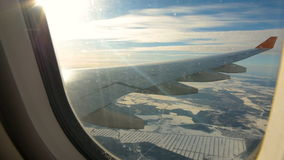 Land seen through the window of jet airplane. Airplane slowly landing. At destination stock video